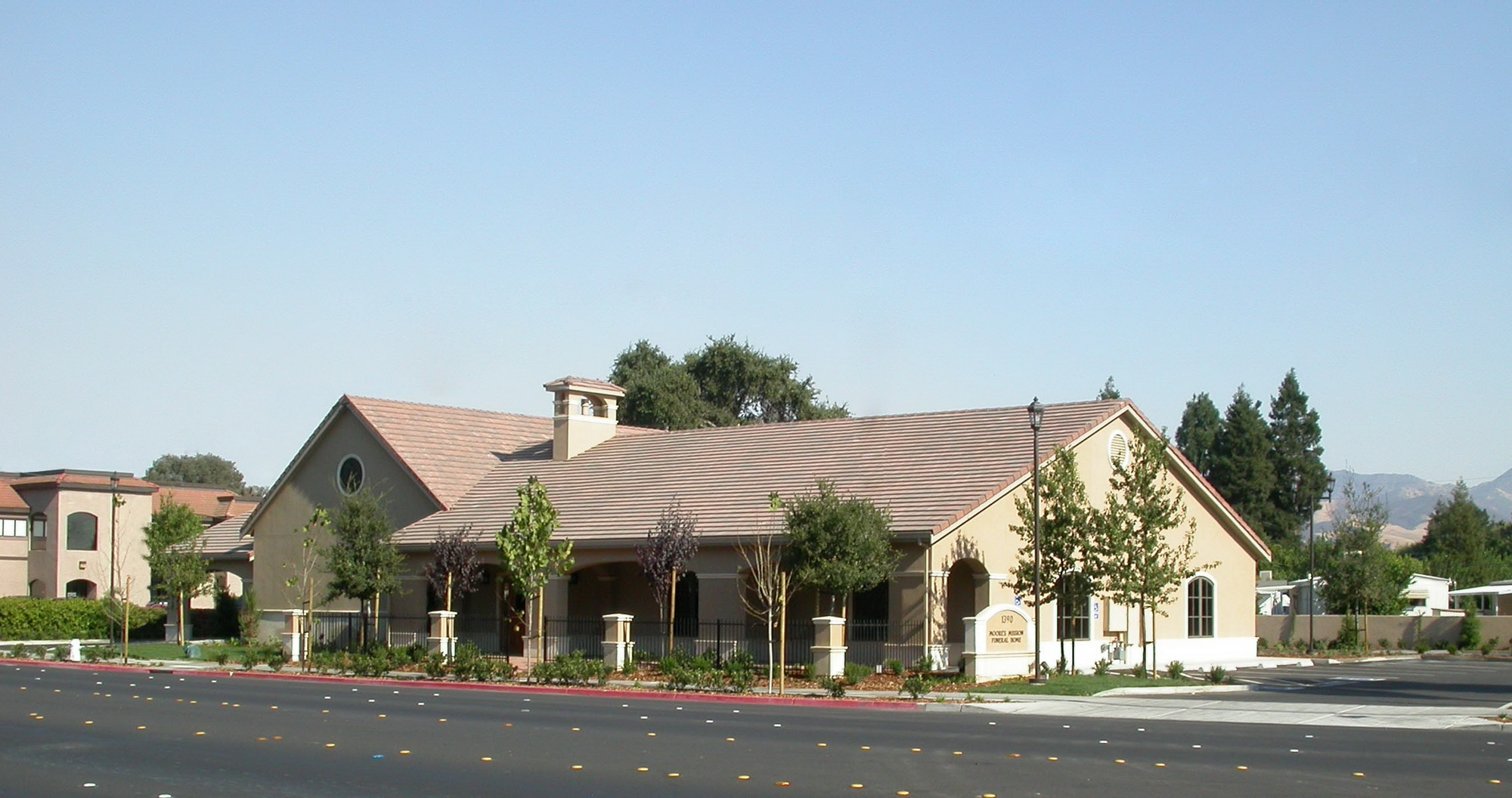Moore 39 s mission funeral home jst architects for Mission home
